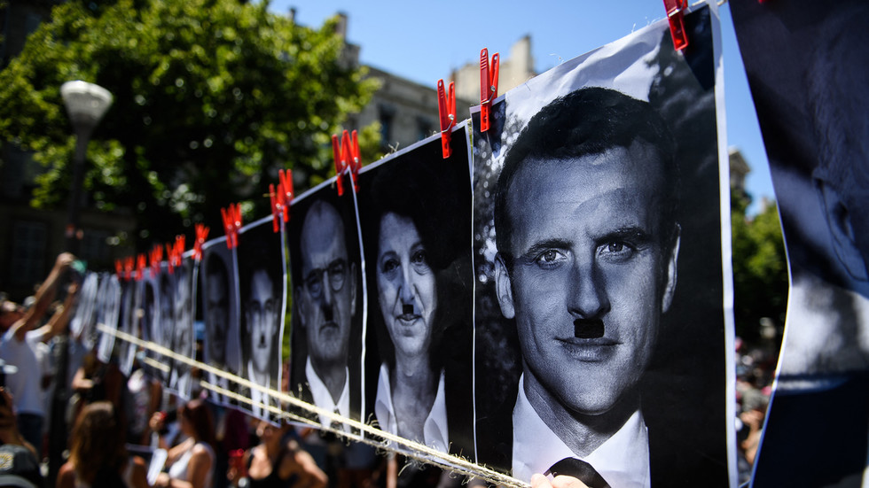 French billboard proprietor hit with €10,000 effective for depicting president Macron as Hitler on Covid protest poster