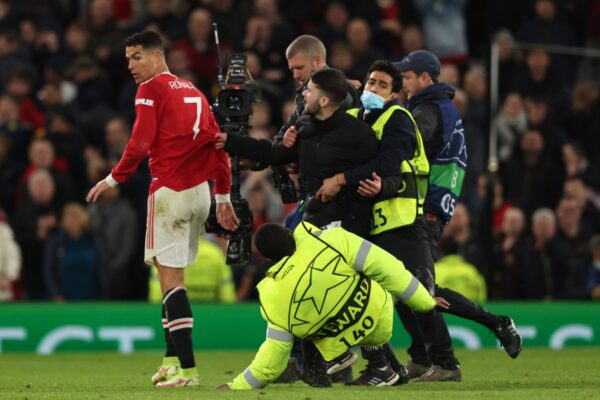 Fan runs onto pitch at Outdated Trafford to seize Cristiano Ronaldo at full-time of Manchester United's sensible comeback win over Atalanta