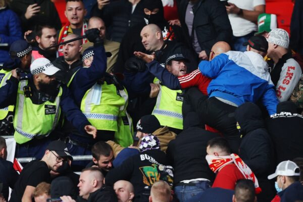 Police compelled to retreat by Hungary followers throwing punches in stands at Wembley after arresting spectator for racially abusing steward throughout World Cup qualifier at England